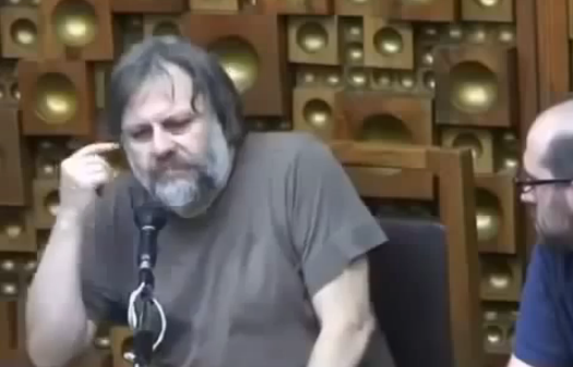 Watch Slavoj Zizek Tell 9 Minutes of Offensive Jokes